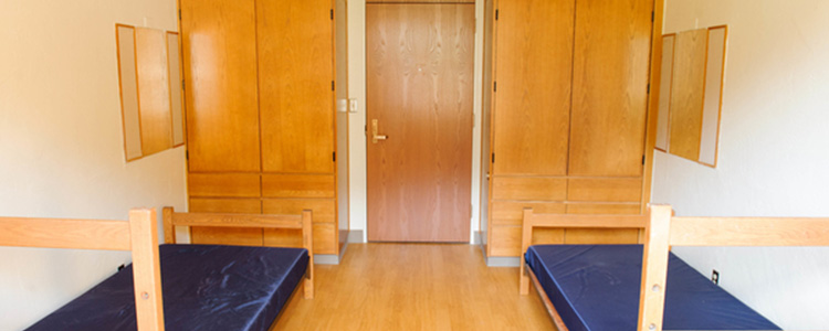 A double room in Mathes Hall, facing the door