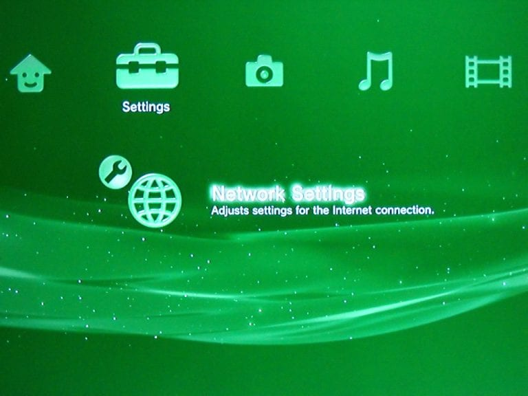 Screencap of PS3 with network settings highlighted under settings.